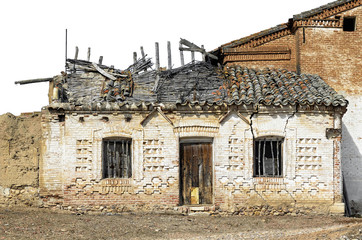 Old house in ruins at abandoned village. Vivid colors on picture without sky. Put it as you want.