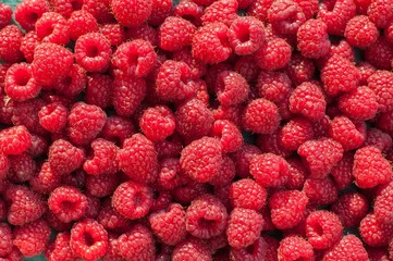 Ripe red raspberries as background