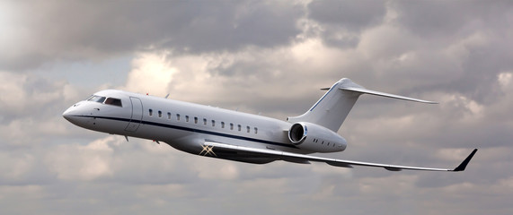 Close up of a private jet flying