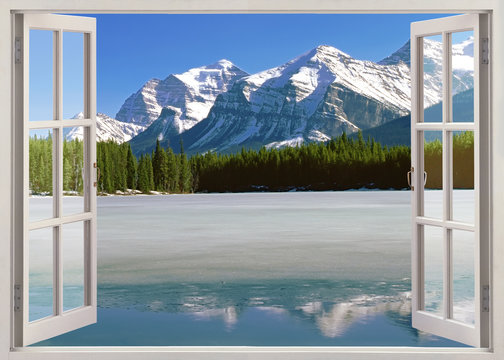 Panoramic view to Canadian Rockies Mountains from open window