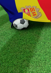 Soccer ball and national flag of Andora,  green grass