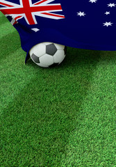 Soccer ball and national flag of Australia,  green grass
