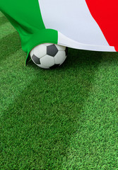 Soccer ball and national flag of Italy, green grass