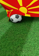 Soccer ball and national flag of Macedonia,  green grass
