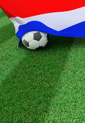 Soccer ball and national flag of Nederland,  green grass