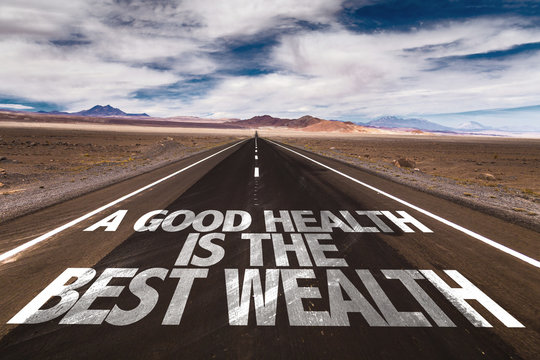 A Good Health is the Best Wealth written on desert road