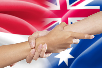 Helping hands with the indonesian and australian flags