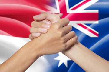 Partnership hands with indonesian and australian flags