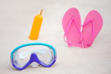 summer - close up of diving mask, flip flops and suntan lotion b