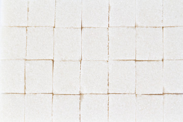 white refined sugar cubes as a background