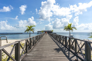 Wooden jetty with blue skies