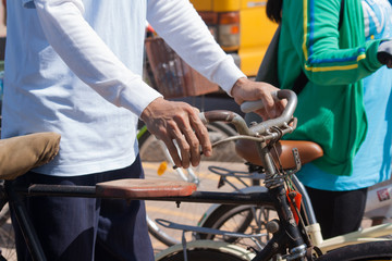 Udon Thani, Thailand, August 16, 2015: bikes for a cycling event at the mother biking together in the streets. Energize the Queen Mother. Handle the hands-down old bicycle, walk, bike.
