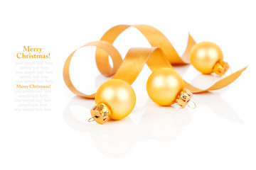 golden christmas decoration balls with satin ribbon, isolated on