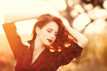 Beautiful girl in plaid dress