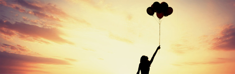 Girl silhouette with balloons