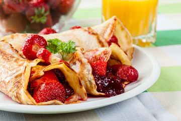Traditional crepes served with strawberries