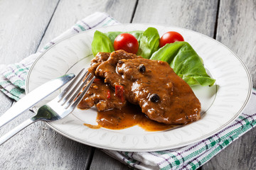 Pork chop with sauce and vegetables