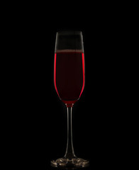 Red wine in a glass isolated on black background