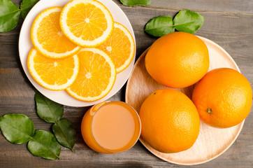 Navel orange fruit and juice on wooden background
