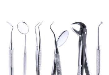 Set of metal medical equipment tools for teeth dental care isolated on white, with clipping path