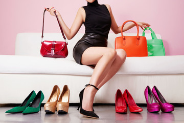 Woman shopping colorful bags and shoes.Beautiful fashion accessories image.
