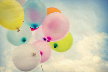 Wall Mural - vintage colorful balloon on blue sky concept of happy birth day, paper art texture
