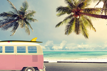 Wall Mural - Vintage car on the beach with a surfboard