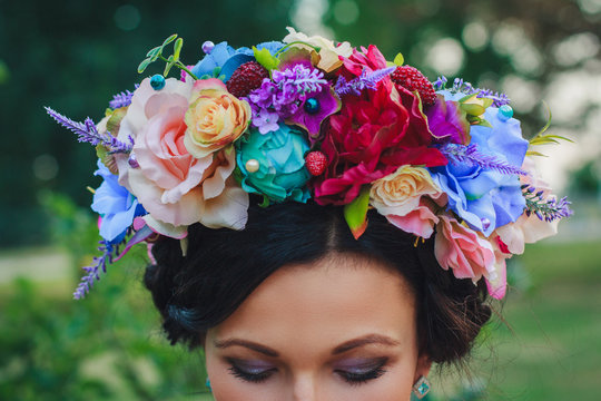 Young attractive woman with coronet of flowers