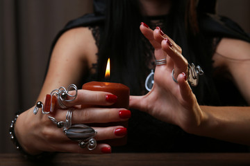 Witch - fortune teller on dark background