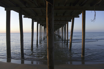 Underneath the pier and the Atlantic Ocean in Virginia Beach, Virginia