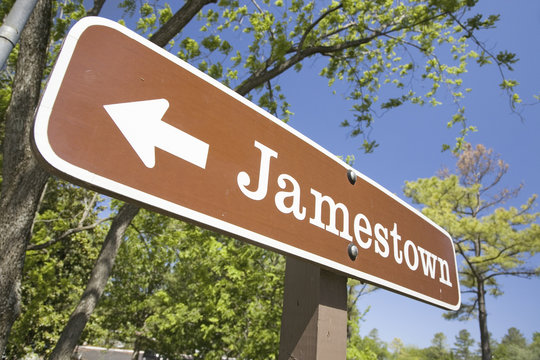 Street sign pointing to Jamestown Settlement in Colonial Williamsburg, Virginia, the site of the 1607 English Colony