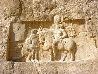 Stone carvings in bas-relief on the Tomb of Darius the Great, at Persepolis, near Shiraz, in Iran. Persepolis became a UNESCO World Heritage Site in 1979.