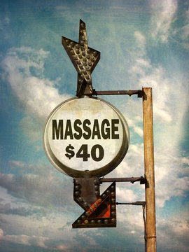 aged and worn vintage photo of massage sign
