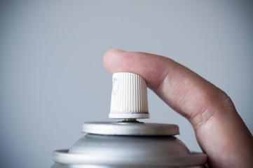 Finger pressing aerosal spray