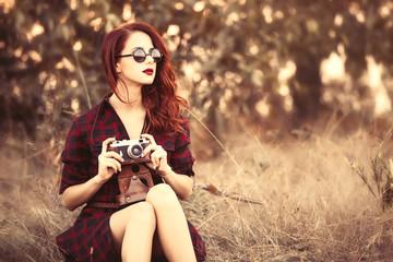 girl in plaid dress retro camera and sunglasses