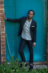 Thoughtful black man outside in suit coat