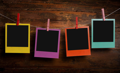 Four color polaroids on a clothesline
