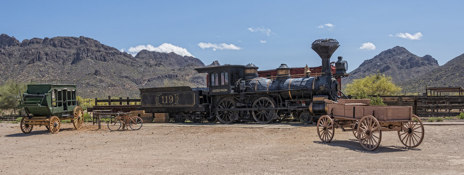 Old Western Steam Engine And Stage Coach