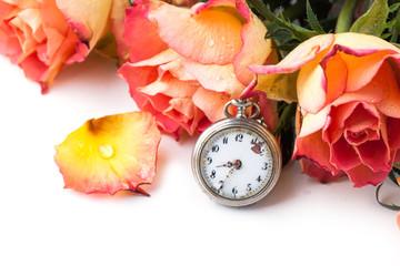 orange roses with vintage clock