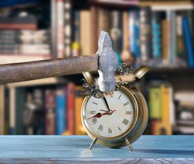 Alarm clock and hammer