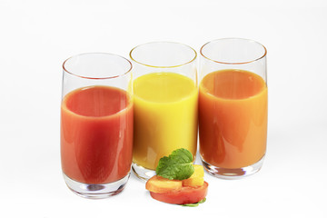 Glasses of tomato, pumpkin, carrot juice