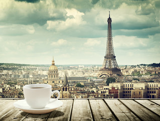 Door stickers Paris background with cup of coffee and Eiffel tower in Paris