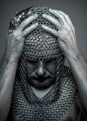 Warrior, medieval executioner mesh iron rings on the head