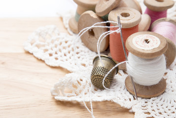 cotton thread for sewing, wound on a wooden spool, white lace