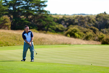 Golf player on the golf field. Cape Kidnappers golf court. New Zealand.