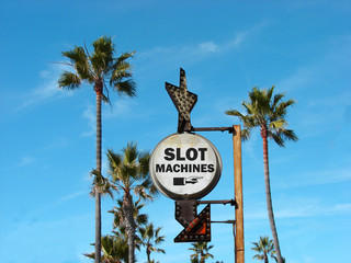 aged and worn vintage photo of slot machines sign