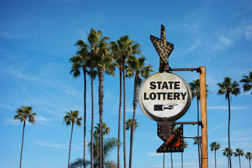 aged and worn vintage photo of state lottery sign