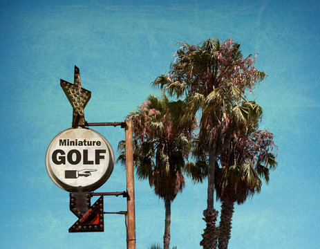 aged and worn vintage photo of miniature golf sign