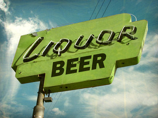 aged and worn vintage photo of liquor and beer sign