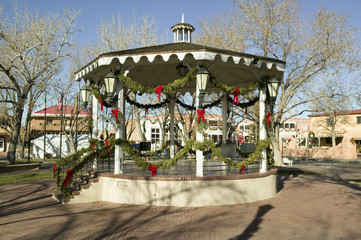 Gazebo wrapped in Christmas dŽcor is in park in Old Town of Albuquerque, New Mexico